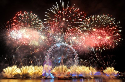 Fireworks explode over the London Eye in central London, as part of the New Year celebrations Tuesday, Jan. 1, 2013. (AP Photo/PA, Dominic Lipinski) UNITED KINGDOM OUT, NO SALES, NO ARCHIVE